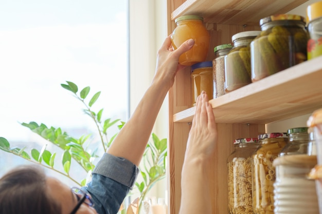 Food products in the kitchen storing ingredients in pantry Premium Photo