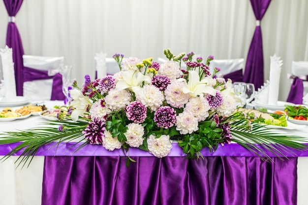 Food table decorated with flowers Premium Photo