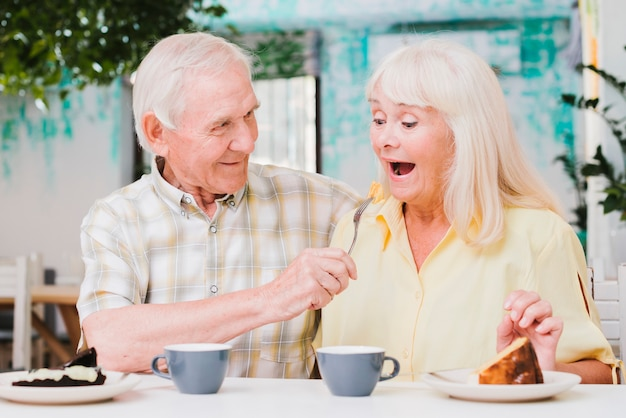 Fooling loving  elderly gray haired couple Free Photo