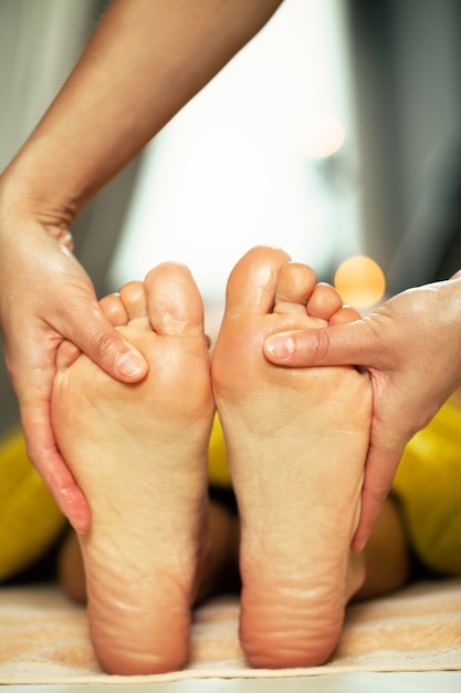 Foot massage for a woman in a spa Free Photo