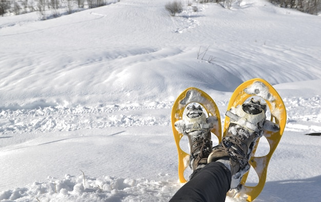 Foot of woman with snowshoes  in the snow Premium Photo