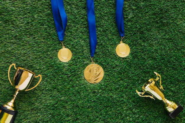 Football background with medals and trophies Free Photo