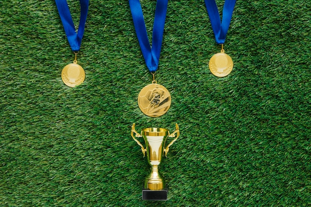 Football background with medals and trophy Free Photo