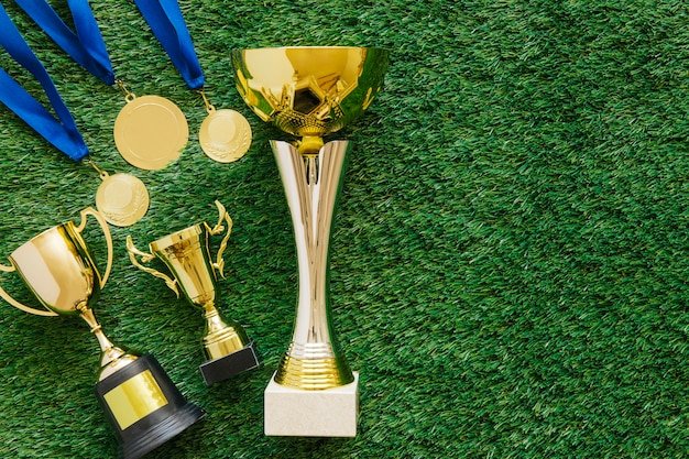 Football background with trophies and copyspace Free Photo