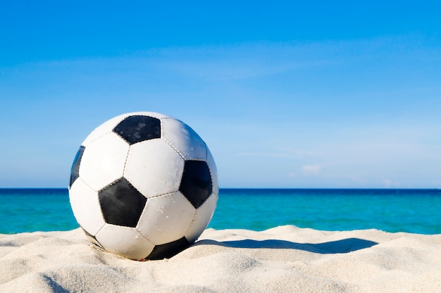 Football on a beach Free Photo
