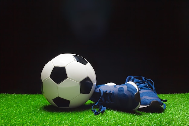 Football boots and ball Premium Photo