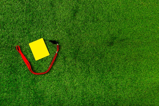 Football composition with copyspace and yellow card Free Photo