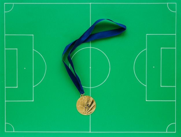 Football composition with medals Free Photo