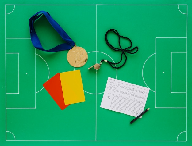 Football composition with referee concept Free Photo