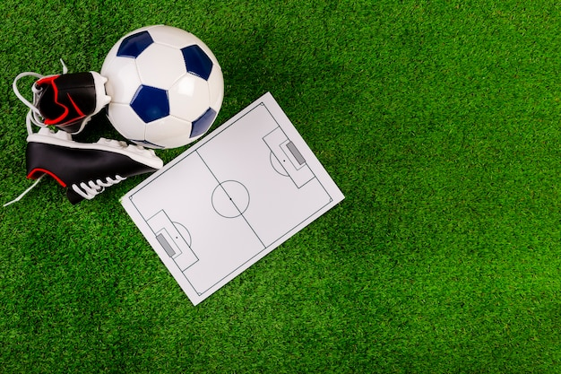 Football composition with tactics board Free Photo