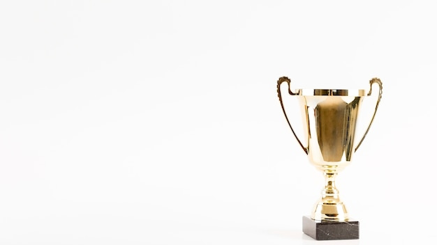 Football composition with trophy and copyspace Free Photo