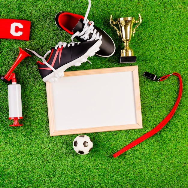 Football composition with whiteboard Free Photo
