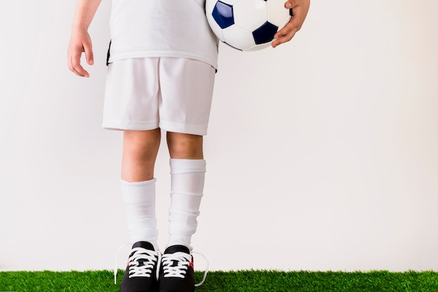 Football concept with girl holding ball Free Photo