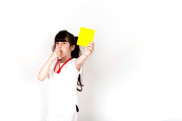 Football concept with girl showing yellow card and copyspace Free Photo