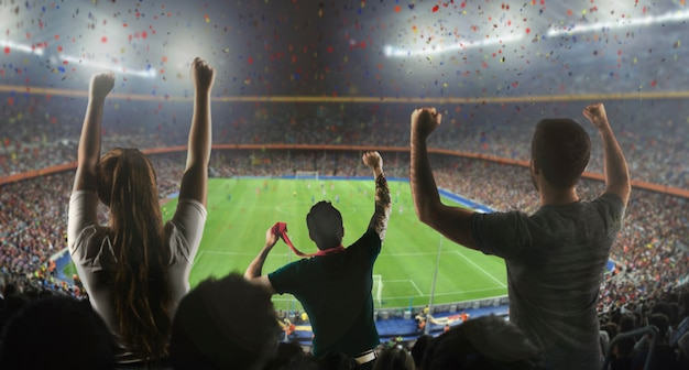 Football fans in stadium from behind Premium Photo