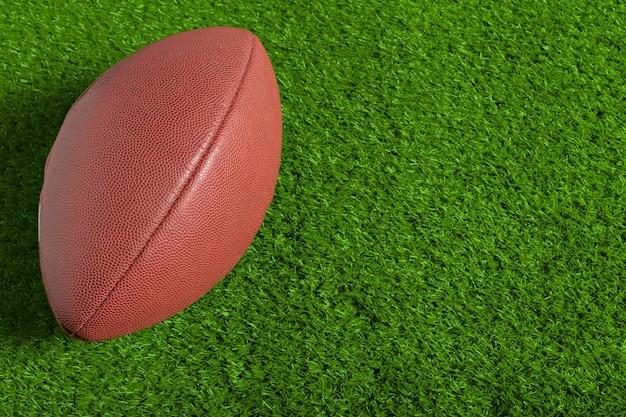 Football in grass Premium Photo
