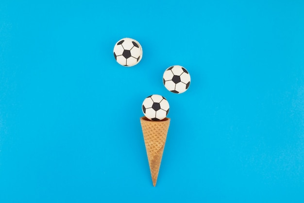 Football macaroons in waffle cones Premium Photo