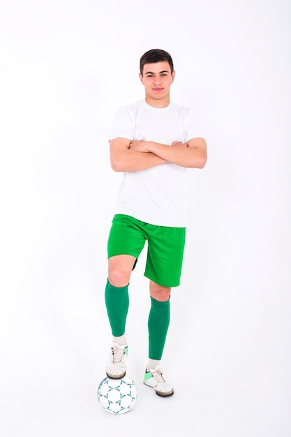 Football player posing with arms crossed Free Photo
