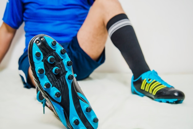 Football player relaxing shoe view Free Photo