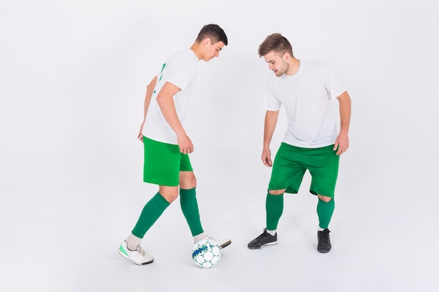 Football players in duel Free Photo