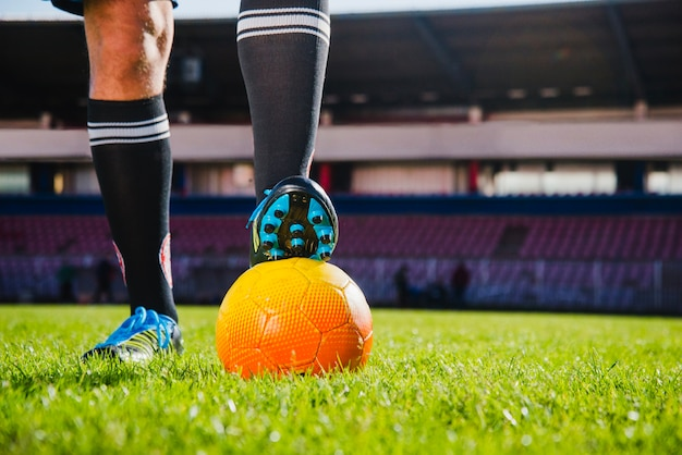 Football scene with ball and legs Free Photo