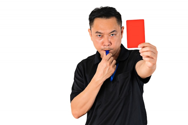 Football or soccer referee showing a red card Premium Photo
