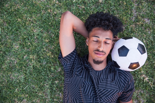 Football sportsman having break on football field Free Photo