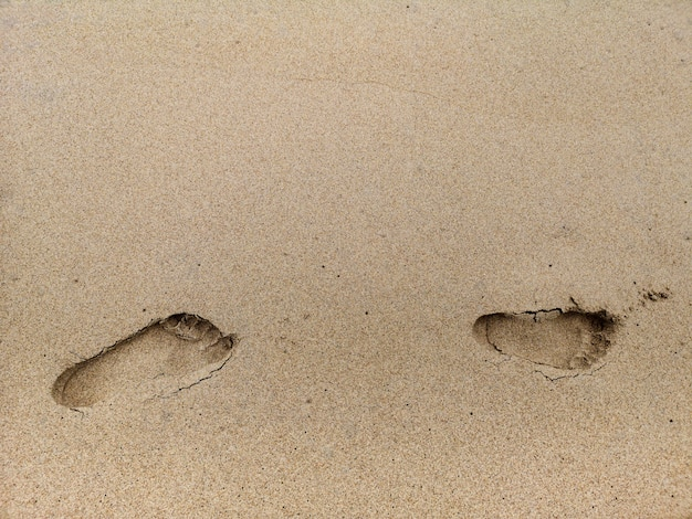 Footprint on the beach sand background. Premium Photo