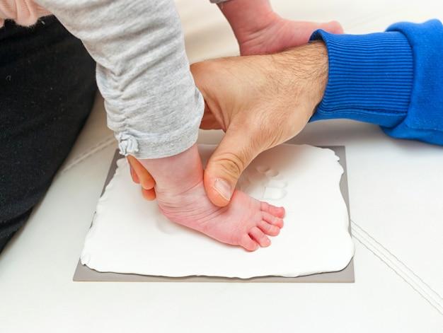 Footprint of a newborn Premium Photo