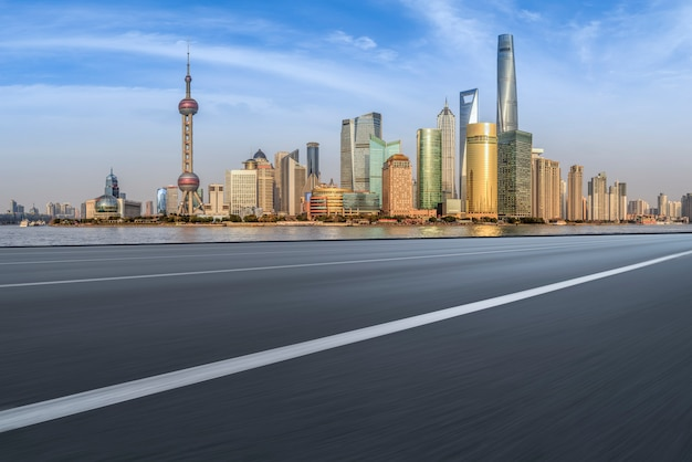 Foreground highway asphalt pavement city building commercial building office building Premium Photo