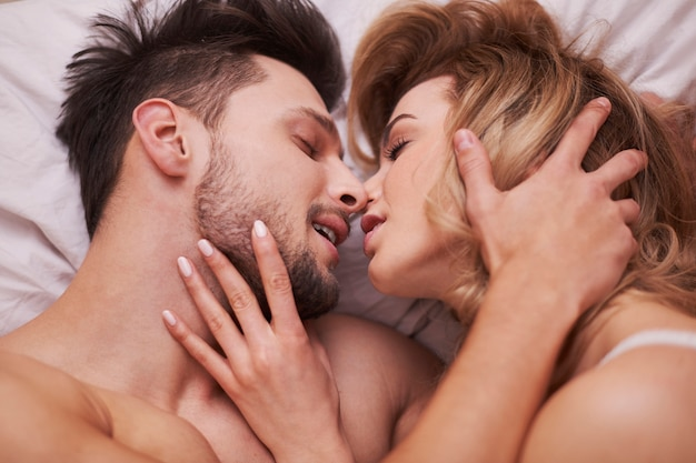The foreplay of passionate couple Free Photo
