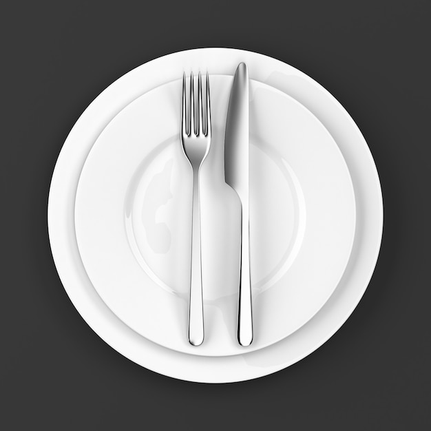 Fork and knife with plates Premium Photo