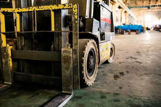 Forklift in the enterprise. old forklift in the manufacturer Premium Photo