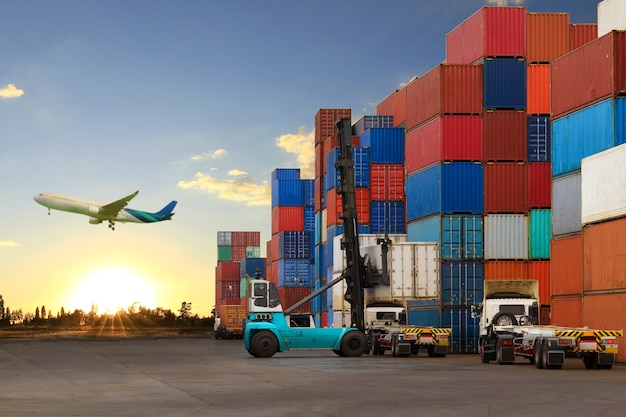 Forklift handling container box loading to truck Premium Photo