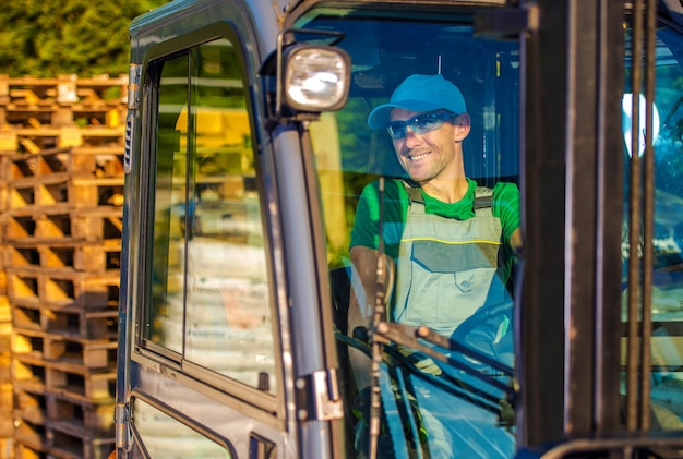 Forklift operator worker Free Photo
