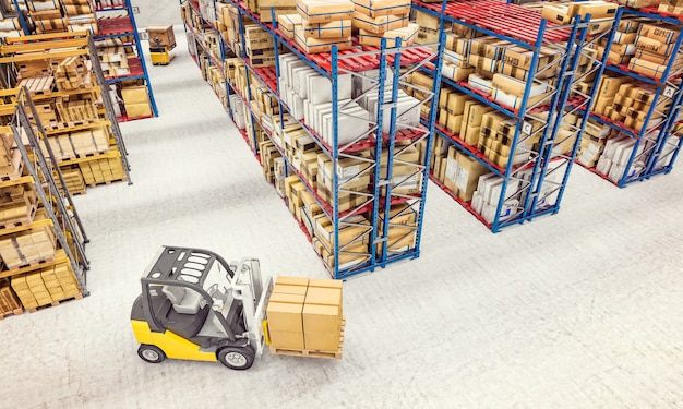 Forklift in warehouse Premium Photo