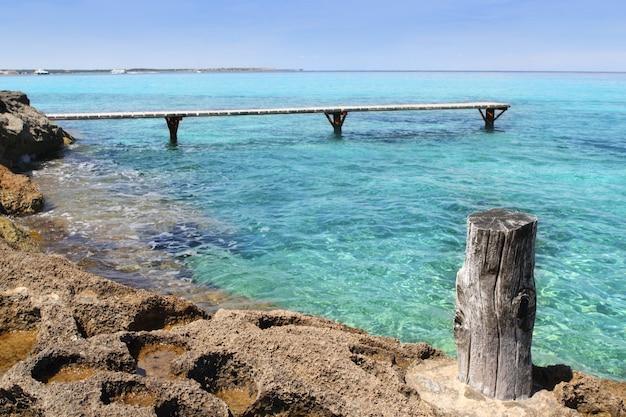 Formentera illetes turquoise sea wooden pier Premium Photo