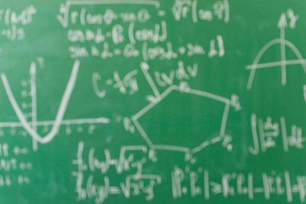 Formulas written by white chalk on school board Free Photo