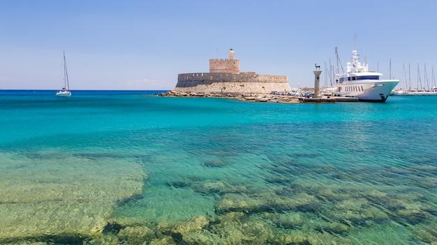 Fort of st. nicholas and mandraki port in rhodes town Premium Photo