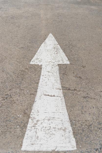 Forward arrow sign on road Premium Photo