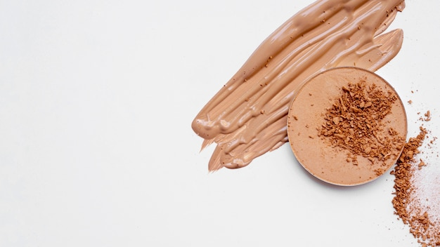 Foundation and powder on white background Free Photo