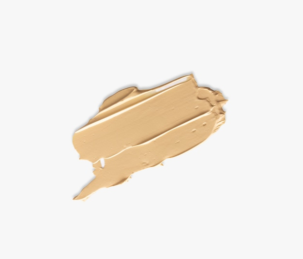 Foundation smeared isolated on white background, swatch face cosmetics. Premium Photo