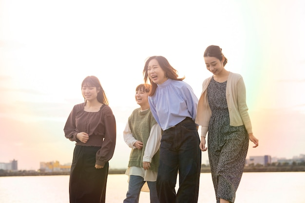 Four asian young women talking happily in the dusk Premium Photo