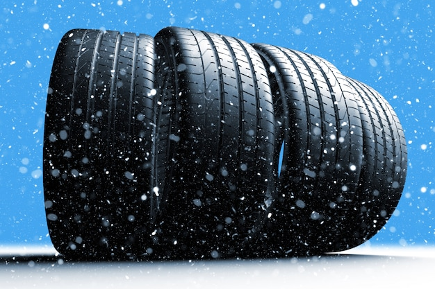 Four car tires rolling on a snow covered road Premium Photo