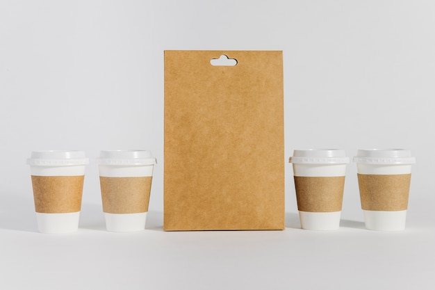 Four coffee cups and bag Free Photo