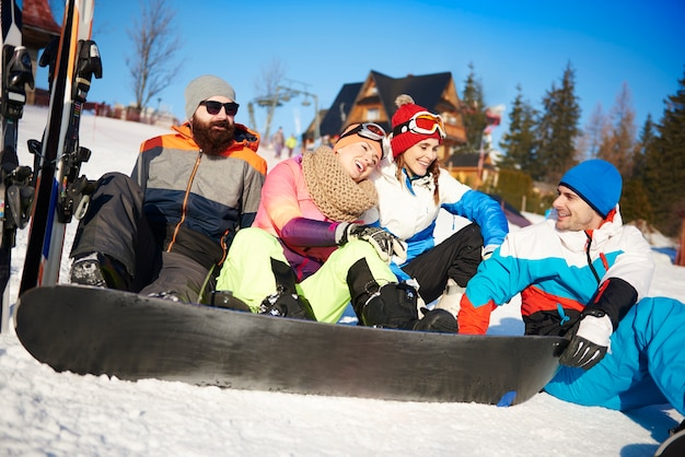 Four of friends with snowboarders on the snow Free Photo