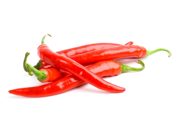Four red chili peppers isolated on white background Premium Photo
