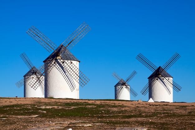 Four windmills in field Premium Photo