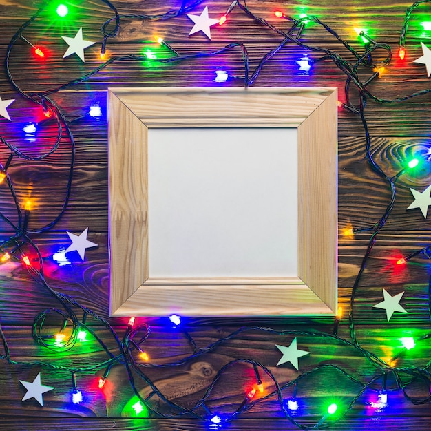 Frame and colorful string lights Free Photo