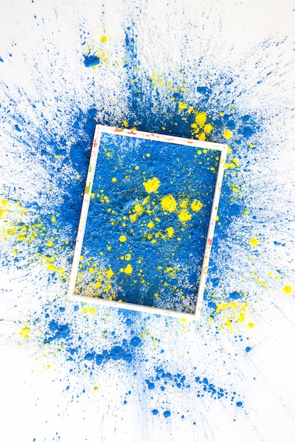Frame on blue and yellow bright dry colors Free Photo